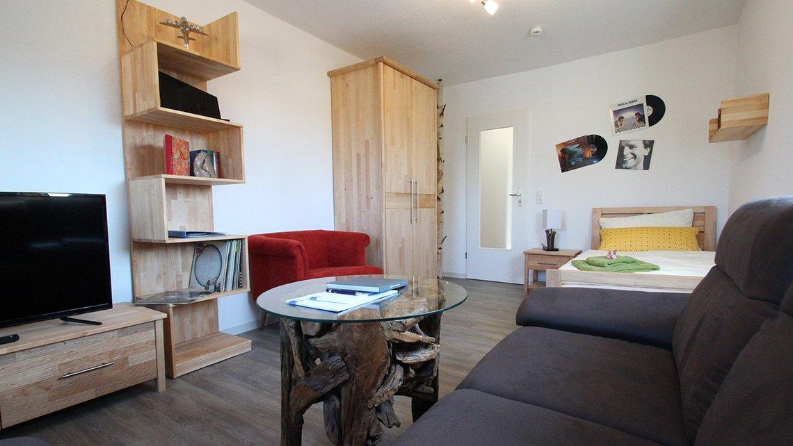 Bild des Wohnzimmers der Gästewohnung Home of Music